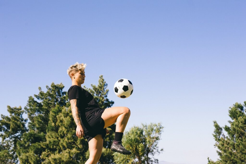 Person playing soccer outside