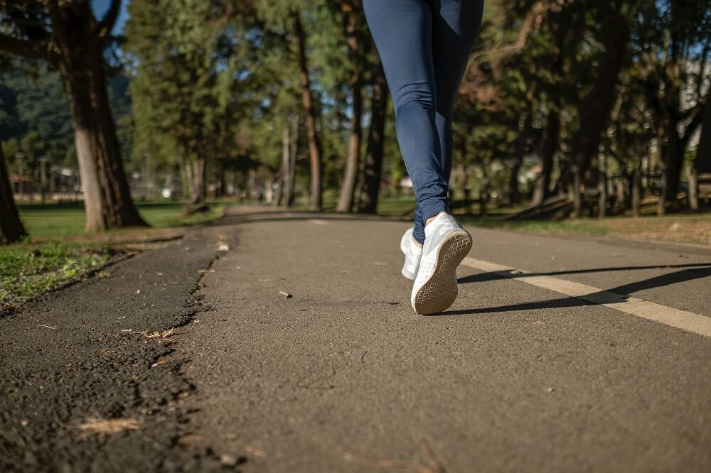Woman going for a walk in the park after lunch to stay active
