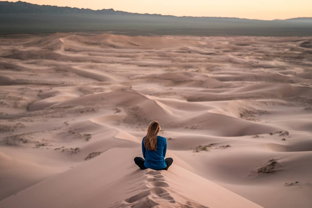 Woman meditating out in nature to relax and relieve stress
