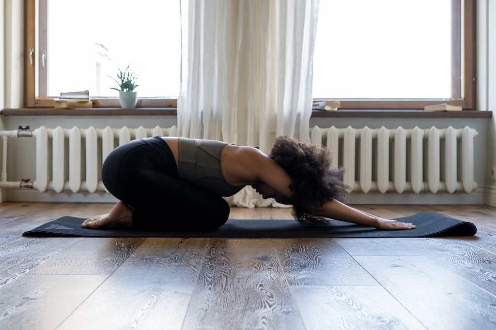Woman doing yoga to reduce stress levels