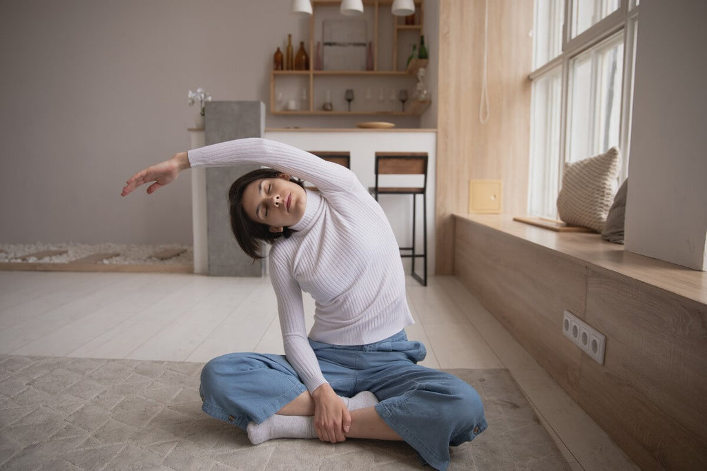 Woman doing stretches at home on the floor