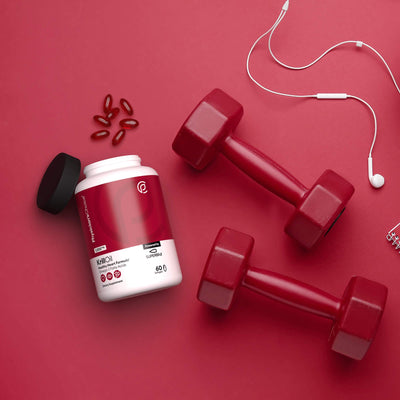 Stylized photo of Physician's Choice Antarctic Krill Oil with Superba2 with weights and headphones