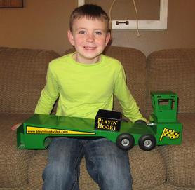Toy Tractor Pulling Sled, Playin' Hooky