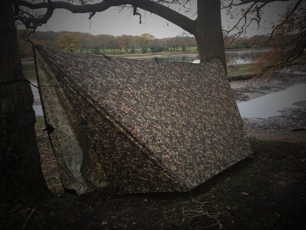 tarp used as a tent over a hammock