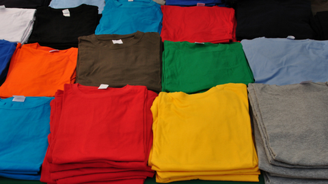 Buy inspirational t-shirts online. Photo of a lot of t-shirts in many different colors.
