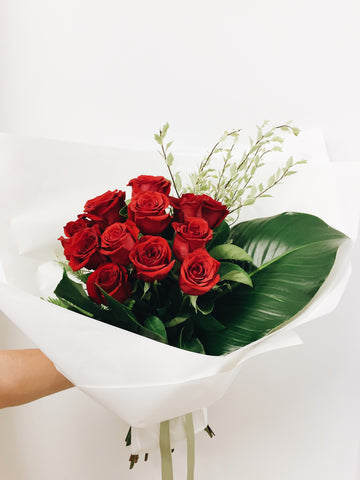 Coolum beach flowers Valentines 12 red roses bouquet delivery Sunshine Coast florist flowers maroochydore buderim peregian spring peregian beach noosa marcoola mudjimba pacific paradise mount coolum