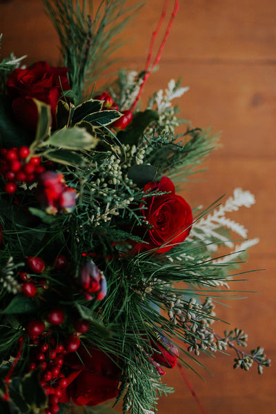 red and green christmas flower centerpiece