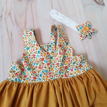 Mustard racer dress with floral highlights