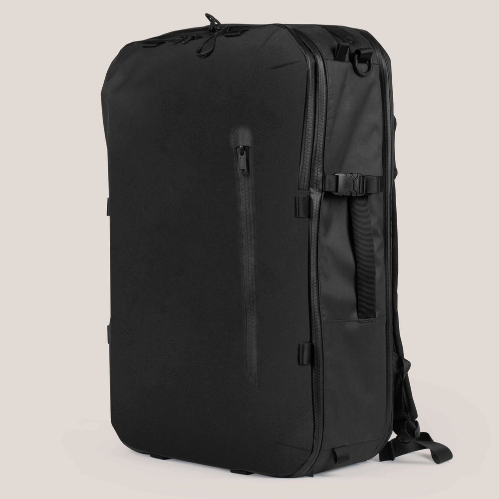42L Carry-On Backpack - Gravel - 42 Liter Backpack closed on a cream background