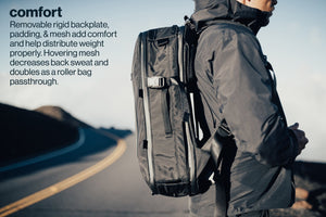 Load image into Gallery viewer, 42L Carry-On Backpack - Gravel - The 42 L has a removable rigid backplate, padding and mess which add comfort and help distributes weight properly. Hovering mesh decreases back sweat and doubles as a roller bag passthrough.