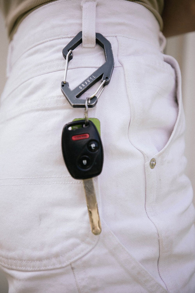 Gravel Carabiner attached to keys on shorts