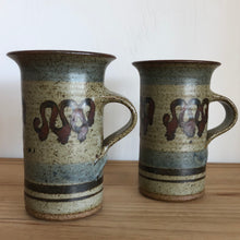 Tall pottery mugs