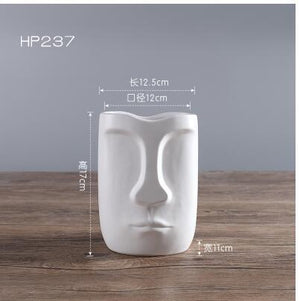Creative abstract Human face ceramic flower vase Dukaiko
