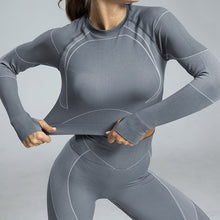 Grey women's seamless fitness top w/ long sleeves open back