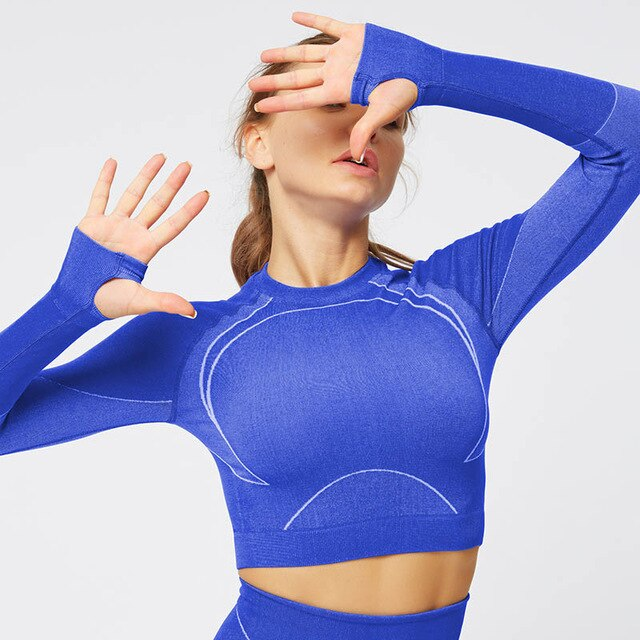Blue women's seamless fitness top w/ long sleeves open back