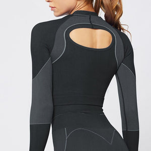 Black women's seamless fitness top w/ long sleeves open back