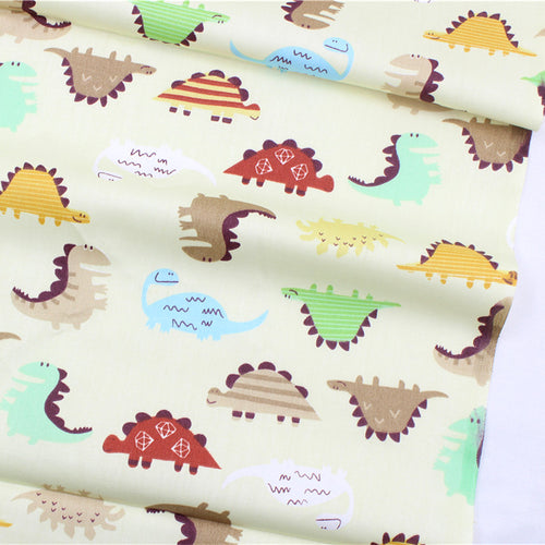 20 inches X 60 inches Beige Cotton Dino Fabric