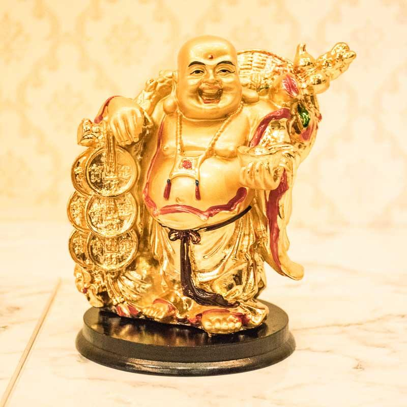 Laughing Buddha Holding Golden Ball