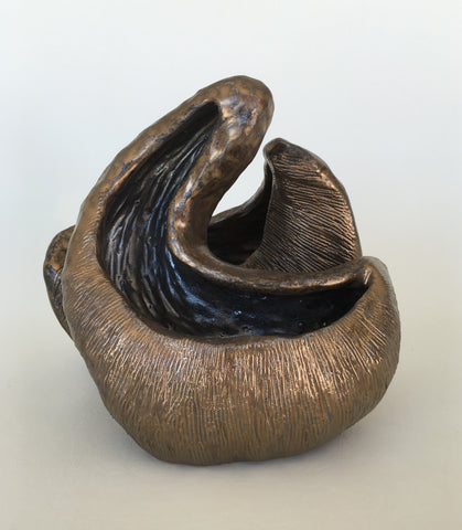Medium ceramic sculpture with two nestled forms with openings