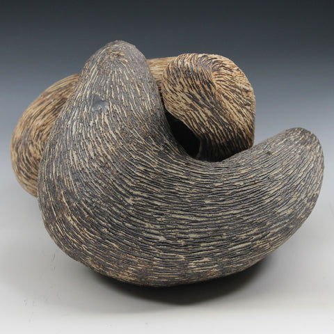 Two interrelated organic forms reminiscent of otters nestled together in a hug. Both can be used as vessels and alternate formations can be arranged by home owner.