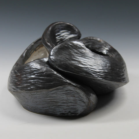 Pewter glazed ceramic sculpture with two nestled organic forms with openings