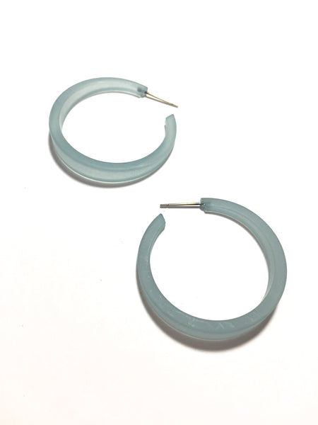 big teal earrings