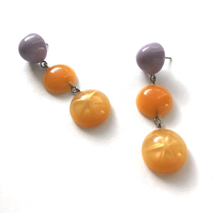 light orange statement earrings