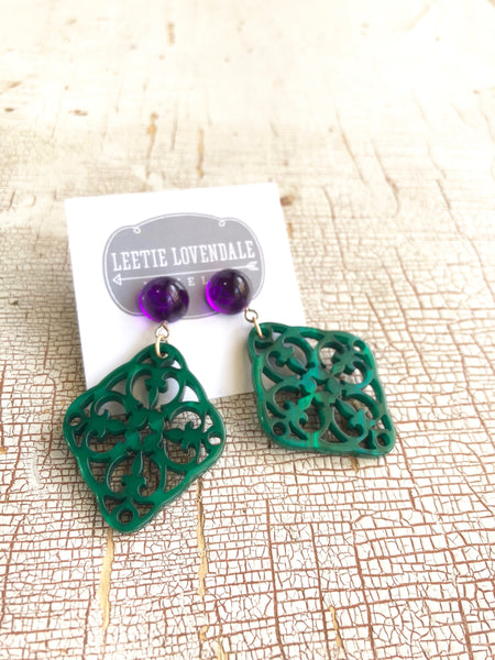 green purple statement earrings