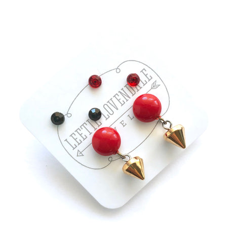 red spike earrings