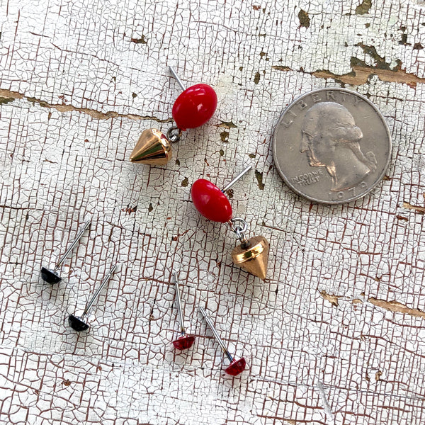 tiny red studs