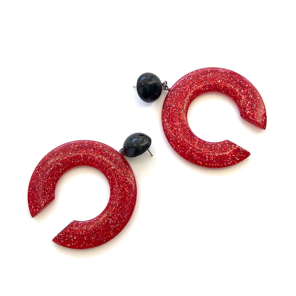 huge red tusk earrings