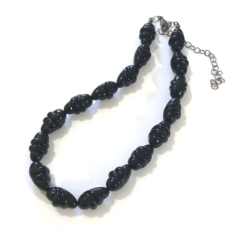 carved black necklace