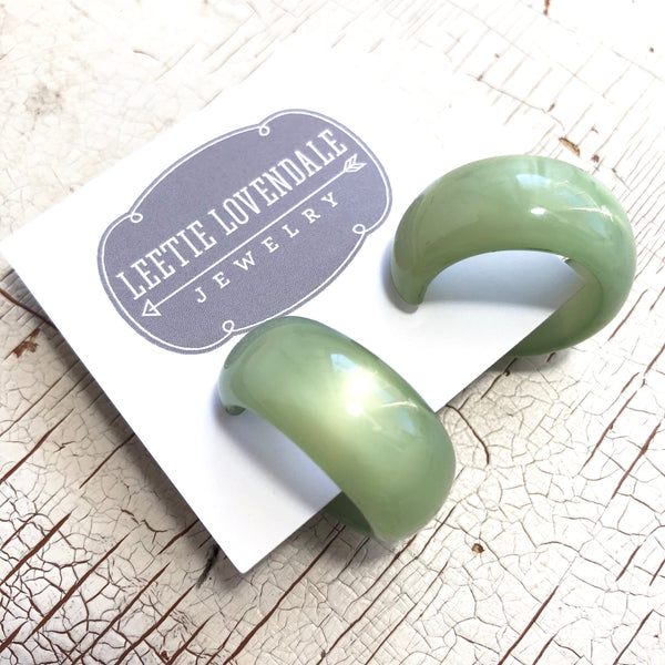 light green moonglow earrings