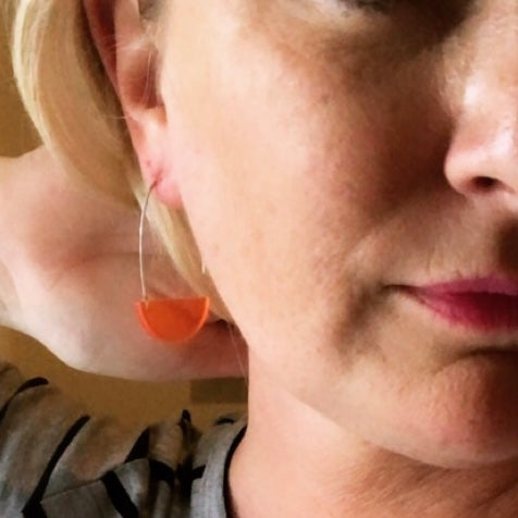 orange half circle earrings
