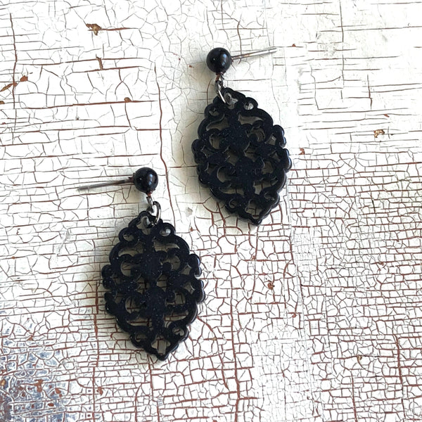 carved black earrings