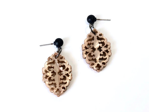 beige statement earrings