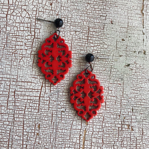carved red statement earrings