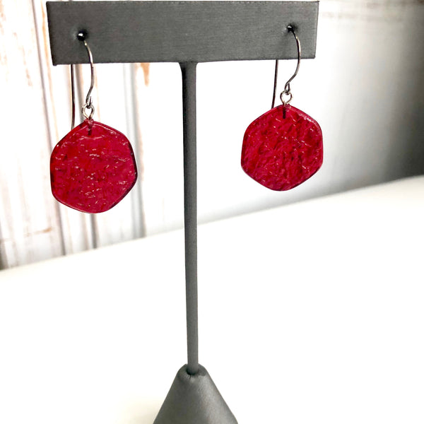 red textured earrings