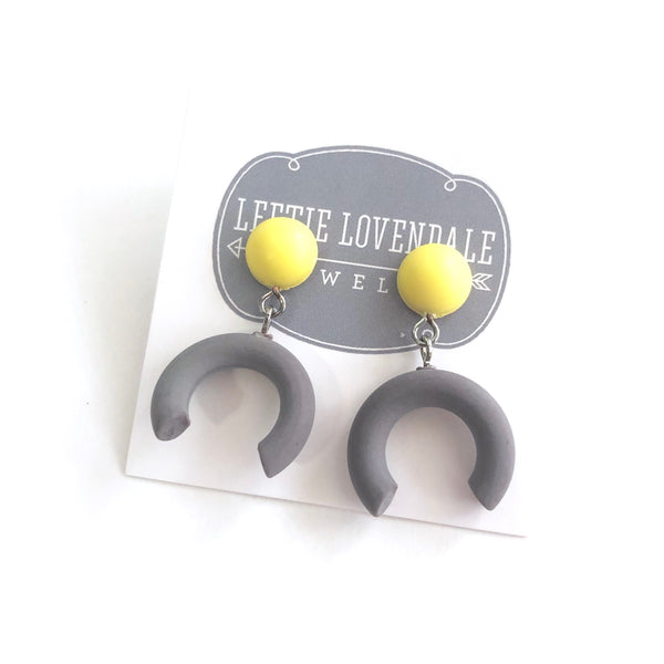 grey yellow statement earrings