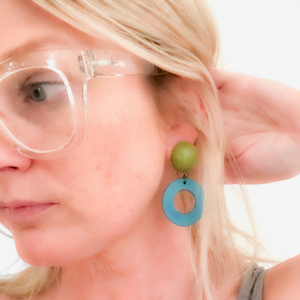 cosmic earrings on model