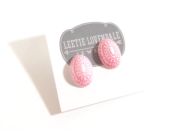 pink nordic studs