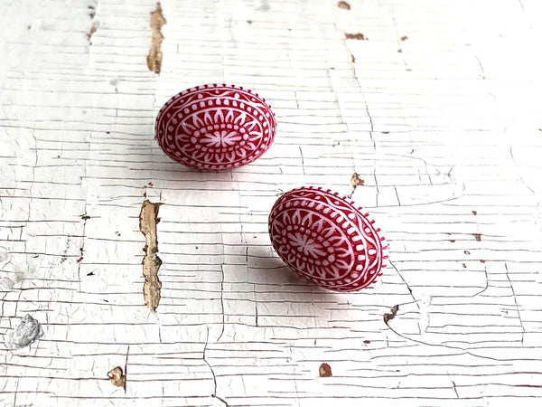 red nordic studs