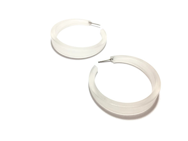 clear phoenix hoop earrings