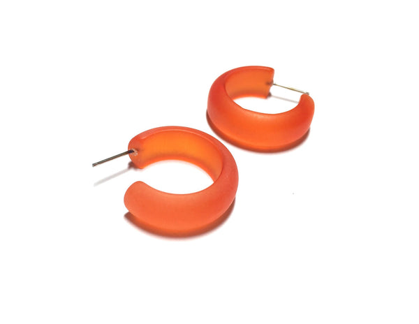 lucite orange hoops