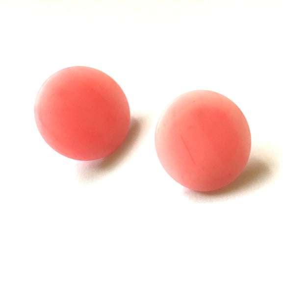 round pink lucite earrings