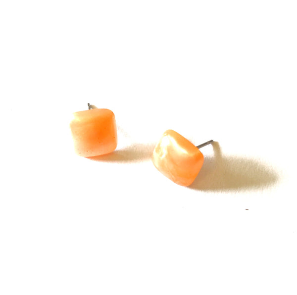 peach stud earrings square