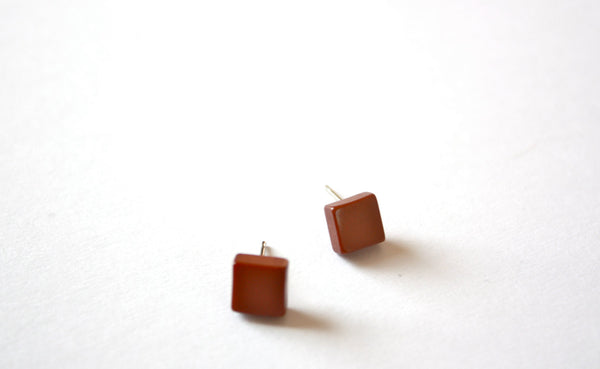 tiny brown studs