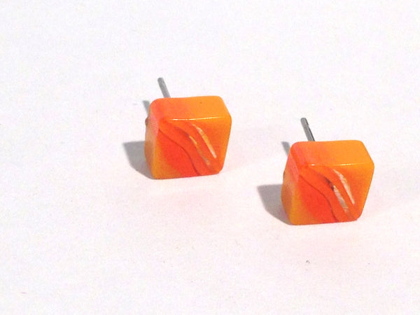 orange stripe studs
