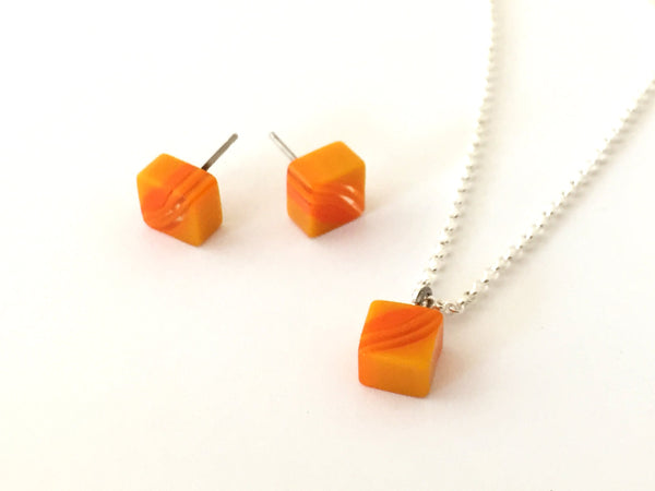 bright orange square studs