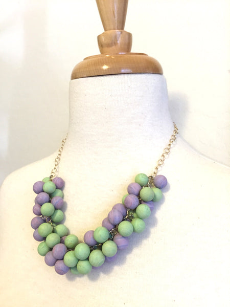 statement necklace pastel tones